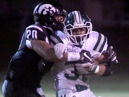 Greenbrier's Brandon Chambers is wrapped up by South