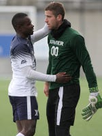 Eric Osswald (right) had six saves in his first match of the MLS Combine in Florida.