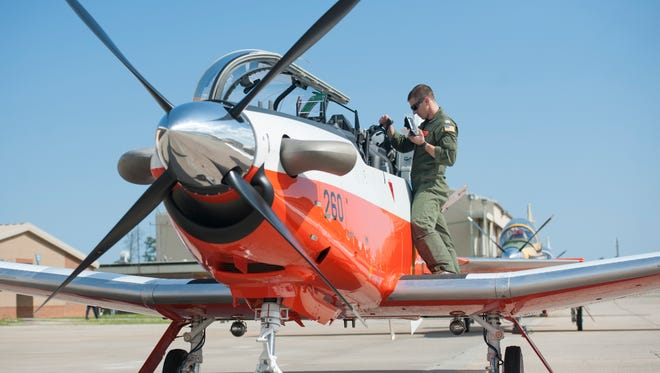 U.S. Navy Lt. Scott Urbashich gets his gear out of the T-6 Texan II B training aircraft on June 21, 2016, at Whiting Field Naval Air Station.