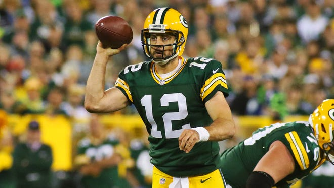 Green Bay Packers quarterback Aaron Rodgers (12) passes against the Seattle Seahawks during the second half at Lambeau Field.