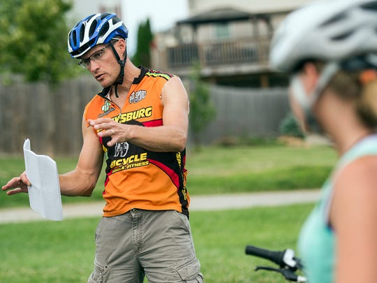 Mike Keefer, head coach of the Hanover Area Youth Cycling Club, explains a balancing drill to his team, Tuesday, July 11, 2017. This will be the second year Hanover Area Youth Cycling Club will compete. It was one of the inaugural teams for the Pennsylvania league.