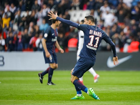 PSG's Angel Di Maria celebrates after scoring during the French League One soccer match between PSG and Montpellier at the Parc des Princes stadium in Paris, France, Saturday, April 22, 2017. (AP Photo/Kamil Zihnioglu)