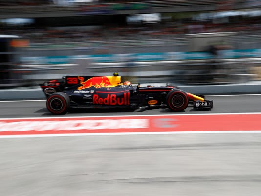 Red Bull driver Max Verstappen of the Netherlands steers his car during the third practice session at the Sepang International Circuit for the Malaysian Formula One Grand Prix in Sepang, Malaysia, Saturday, Sept. 30, 2017. (AP Photo/Eric To)