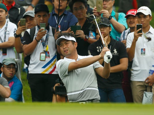 Yuta Ikeda of Japan watches his shot on the 9th hole during the foursome matches of the 2018 EurAsia Cup golf tournament at Glenmarie Golf & Country Club in Shah Alam, Malaysia, Saturday, Jan. 13, 2018. (AP Photo/Sadiq Asyraf)