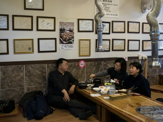 A Korean family eats at a traditional restaurant in Jeongseon, South Korea, Thursday, Feb. 15, 2018. Korean food is some of the world's finest - savory, salty soups with fish so tender it falls off the bone; thick slabs of grilled pork and beef backed with spicy kimchi that many Korean grandmothers swear cures the common cold. But it's very different from what many foreign Olympians are used to.  (AP Photo/Felipe Dana)