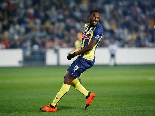 bdfaf7bcd Australia Soccer Usain Bolt 85572.jpg. Usain Bolt overruns across the pitch  during a friendly trial match between the Central Coast Mariners ...