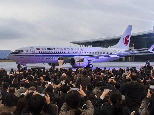 In this Dec. 15, 2018, photo released by Xinhua News Agency, invited guests take photos of the Boeing 737 Max 8 airplane deliver to Air China during a ceremony at Boeing Zhoushan 737 Completion and Delivery Center in Zhoushan, east China's Zhejiang Province. China's civilian aviation authority has ordered all Chinese airlines to ground their Boeing 737 Max 8 planes on March 11, 2019 after one of the aircraft crashed in Ethiopia.