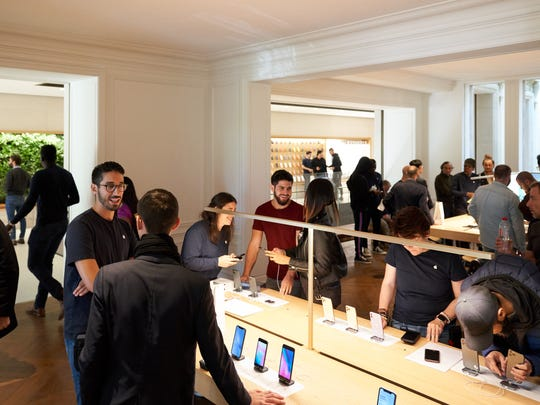 Customers shopping inside an Apple store