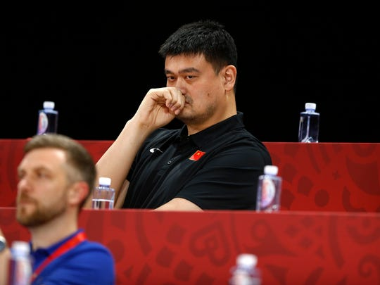 FILE - In this Sept. 4, 2019, file photo, Yao Ming, head of the Chinese Basketball Association and former NBA player, watches as China and Venezeula compete during their group phase basketball game in the FIBA Basketball World Cup at the Cadillac Arena in Beijing. Yao is now president of the Chinese Basketball Association, which announced over the weekend it is suspending its ties with the Rockets in retaliation for Houston Rockets general manager Daryl Morey's tweet that showed support for Hong Kong anti-government protesters. (AP Photo/Mark Schiefelbein, File)