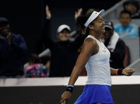 Naomi Osaka of Japan reacts while competing against Ashleigh Barty of Australia during their women's final at the China Open tennis tournament in Beijing, Sunday, Oct. 6, 2019. (AP Photo/Mark Schiefelbein)
