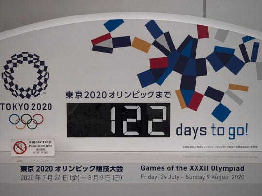 """A countdown display for the Tokyo 2020 Olympics is photographed in Tokyo, Tuesday, March 24, 2020. IOC President Thomas Bach has agreed """"100%"""" to a proposal of postponing the Tokyo Olympics for about one year until 2021 because of the coronavirus outbreak, Japanese Prime Minister Shinzo Abe said Tuesday. (AP Photo/Jae C. Hong)"""