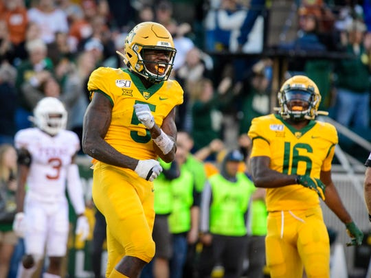 Nov 23, 2019; Waco, TX, USA; Baylor Bears wide receiver Denzel Mims (5) celebrates during the game against the Texas Longhorns at McLane Stadium. Mandatory Credit: Jerome Miron-USA TODAY Sports