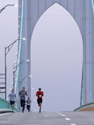 Runners cross the Newport Pell Bridge during the annual Pell Bridge Run. This year's event has been canceled due to coronavirus-related concerns.