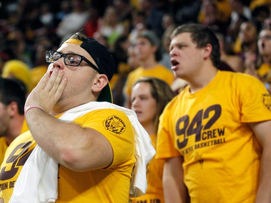 Tim Schodt, left. and Trevor Zero cheer for their team as the Arizona State Sun Devils host USC in their NCAA basketball game Sunday, Feb. 22, 2015 in Tempe,  Ariz.