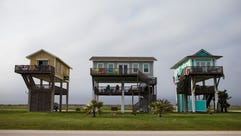 Beach houses line highway 87 on Saturday, March. 10,