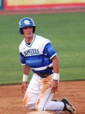 Grant Wassom looks to home plate after reaching second safely.