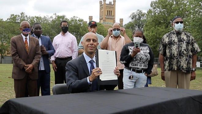 Providence Mayor Jorge Elorza displays the executive order he signed Wednesday morning to explore, share findings about and make reparations for the historical mistreatment of Black and Indigenous people in Rhode Island.