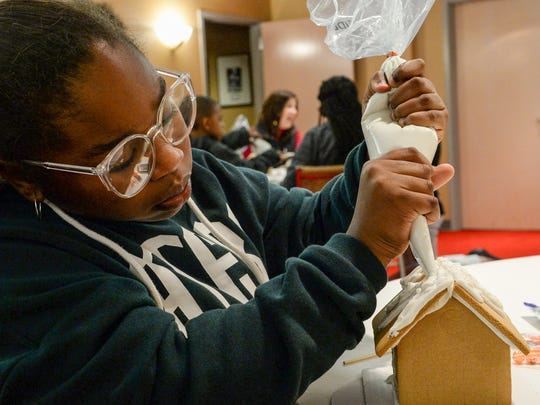 Selena Gambrell of Anderson, enrolled in the Big Brother Big Sisters of the Upstate decorated gingerbread houses at the Anderson County Museum in Anderson on Tuesday.