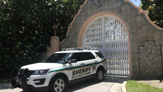 Extra law enforcement authorities are outside President Donald Trump's Mar-a-Lago estate on Sunday, May, 31, 2020.