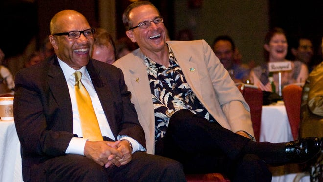 Lindsay Terry/The News-Press----Fort Myers City Manager William Mitchell, left and Fort Myers Beach Town Manager Terry Stewart listen to Bonita Springs Mayor Ben Nelson during The Roast of Gary Price at the Hyatt Regency Coconut Point Resort and Spa in Bonita Springs Wednesday 5-25-11.