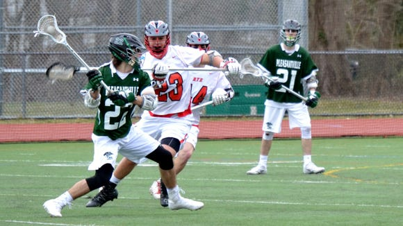 Pleasantville's Brian Reda (22) unleashes a shot with Owen Reda leaning on his back during the Panthers' 12-7 win at Rye.
