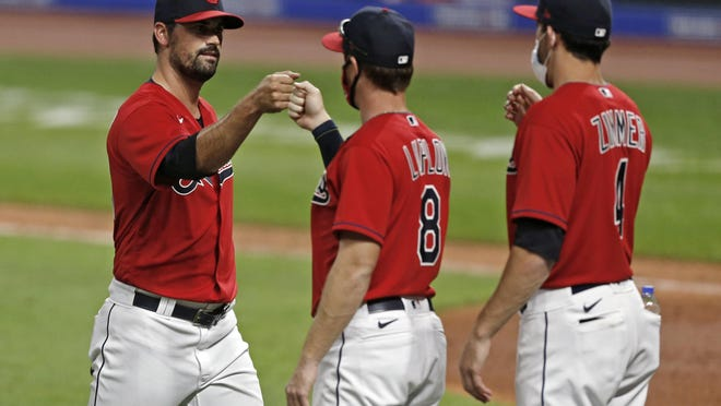 Cleveland Indians relief pitcher Adam Plutko, left, is congratulated by Jordan Luplow (8) and Bradley Zimmer (4) after the Indians defeated the Cincinnati Reds 13-0 in a baseball game baseball game at Progressive Field, Thursday, August 6, 2020, in Cleveland.