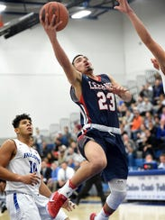 Lebanon's Luis Aquino-Rios drives to the basket late