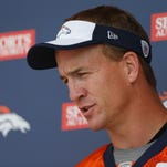 Denver Broncos quarterback Peyton Manning talks with reporters Wednesday.