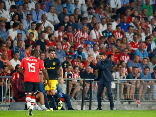 Atletico coach Diego Simeone, right, gestures during the Group D Champions League soccer match between PSV Eindhoven and Atletico Madrid at the Philips stadium in Eindhoven, Netherlands,Tuesday Sept. 13, 2016. (AP Photo/Peter Dejong)