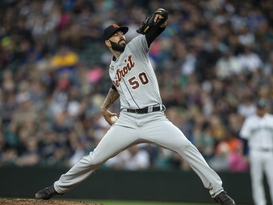 Mike Fiers of the Detroit Tigers delivers during the