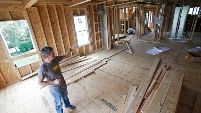 """Jason Long, owner of Black Diamond Construction Company, shows the inside of a home he developed at 1342 Herschel Ave. in Mount Lookout. """"I try to build houses that fit in with the neighborhood,"""" said Long."""