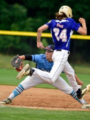 Shippensburg's Nate Holt (24) can't quite beat the throw to Hampden Township first baseman Nick Macciko during their Region 4 American Legion tournament game Monday.