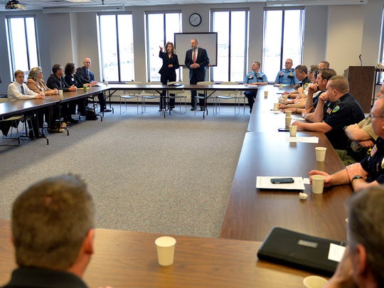 Stearns County Attorney Janelle Kendall introduces U.S. Attorney Andy Luger during a meeting with area lawyers and law enforcement officials Tuesday afternoon at the Stearns County Administration Building.