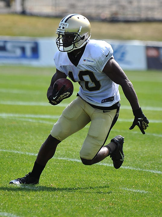New Orleans Saints wide receiver Brandin Cooks (10) runs the ball during there NFL football training camp in White Sulphur Springs, W.Va., Thursday, July 31, 2014. (AP Photo/Chris Tilley)