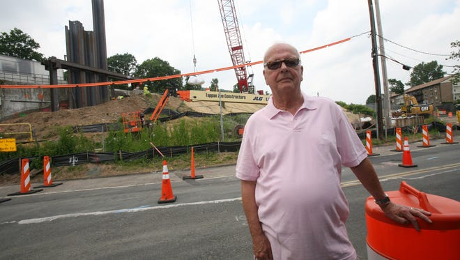 Thomas Neff, a South Nyack resident at Salisbury Point, and a village trustee, stands near the construction of sheet piles adjacent the the northbound Thruway, June 25, 2014.