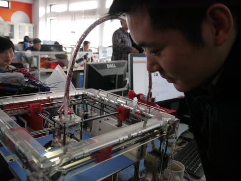 A 3-D printer is used at DF Robot in Shanghai to make products such as iPhone cases and high heel shoes. China is behind the U.S. in using 3-D printing in manufacturing, but it is investing heavily to catch up.
