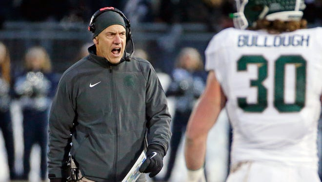 Michigan State head coach Mark Dantonio shouts to an official during the second half of an NCAA college football game against Penn State in State College, Pa., Saturday, Nov. 29, 2014.