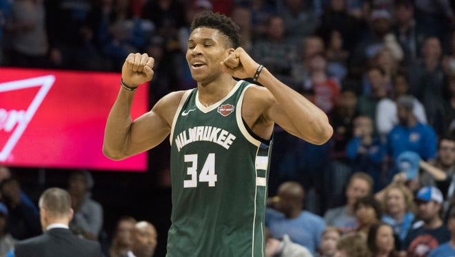 Bucks forward Giannis Antetokounmpo celebrates his disputed winning basket Friday night.