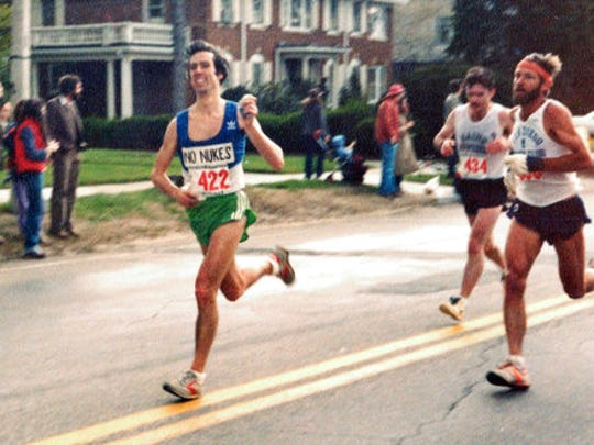 In this April 20, 1981, photo provided by Carol M. Beach, her husband Ben Beach, age 31, runs along the Boston Marathon course in Newton, Mass. Beach, of Bethesda, Md., is looking to be the first person to run the race 50 years in a row on Monday, April 17, 2017.