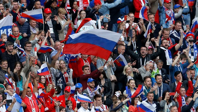 Fans wave Russian flags after their team 5-0 win over Saudi Arabia.