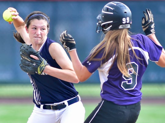 Chambersburg's Maggie Myers fires the ball to first base to complete a double play after getting the runner, Carli Benozich of Upper Darby, out at second base. The Trojans beat the Royals 7-2 in a PIAA first-round game Monday.