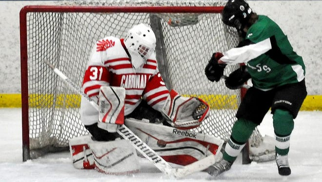 Pacelli goalie Trent Kollock makes one of his 21 saves in a 1-0 victory over Rhinelander/Three Lakes in a WIAA regional opener at Ice Hawks Arena on Tuesday night.