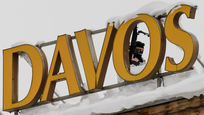 A member of Swiss special police forces stands on the roof of the Kongress Hotel next to the Congress Center, on the eve of the opening of the 46th Annual Meeting of the World Economic Forum in Davos, Switzerland.