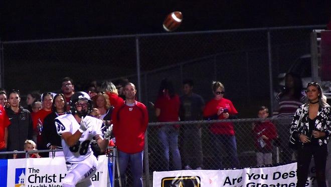 Evan Yablonsky (88) of Lakota East looks in a long pass for a Thunderhawks touchdown, Sept. 29, 2017.