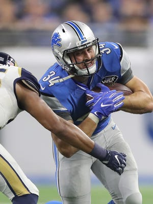Lions running back Zach Zenner carries the ball against the Los Angeles Rams during the second half Sunday, Oct. 16, 2016 at Ford Field in Detroit.