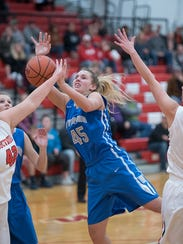 Wynford's Olivia Grove battles for a loose ball.