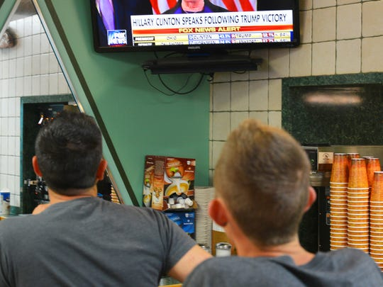 Wednesday morning found people exited or shocked about the election results. At Corey's  Bagels on Eau Gallie Blvd. Christopher Hamaker and Joseph Antab watch Hillary Clinton's concession speech.