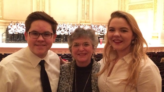 Riverdale High School student Nick True, adviser  Brenda Williams and student Savannah Gannon pose at Carnegie Hall in New York City in February. True and Gannon were selected to perform at the historic venue as part of the Honor Performance Series National Honor Choir.