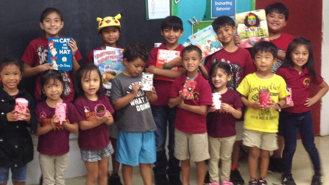 On February 13 at Capt. H.B. Price Elementary School the fourth-grade G.A.T.E. students read books and made a Valentine-themed pencil holder with the Pre-school G.A.T.E. students in Ms. Dela Cruz's class. Pictured back row from left: Drayvin Gumataotao, Robert O'Brien, Taelor Mafnas, Felicita Pangelinan, Savian Sablan, Taga Blas, and Dano Pangelinan.Front row from left: Zeke Aguon, Isis Tudela, Izabella Sablan, Sofia Sablan, Olivia San Nicolas, Meconah Manglona, Damian Pomare, Amory Bamba, Micheal Tokito, and Gianni Gutierrez