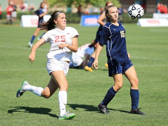 Following the bouncing ball are Canton's Hannah Lapko (left) and Stoney Creek's Amelia Kuntzman.